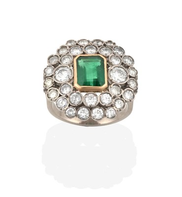 Lot 2022 - An Emerald and Diamond Ring, the emerald-cut emerald in a yellow rubbed over setting, within a...