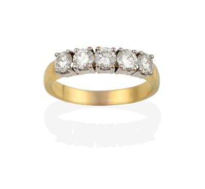 Lot 2023 - An 18 Carat Gold Diamond Five Stone Ring, the round brilliant cut diamonds in white claw...