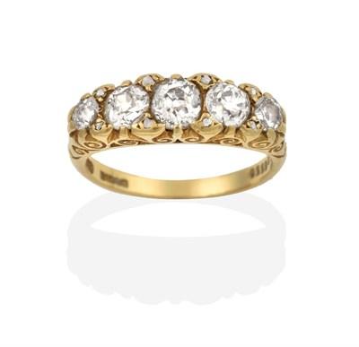Lot 2024 - An 18 Carat Gold Diamond Five Stone Ring, the graduated old cut diamonds with rose cut diamond...