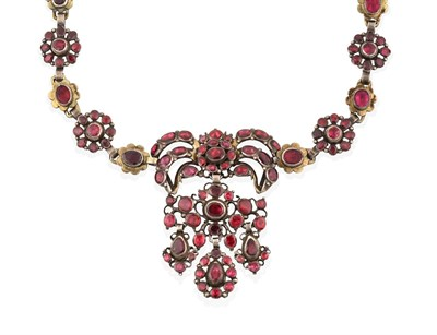 Lot 2025 - A Garnet and Red Stone Necklace, the central panel formed of a bow motif suspends a scroll motif to