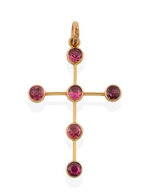 Lot 2026 - A Purplish Pink Stone Cross Pendant, the cross set throughout with six round cut purplish pink...