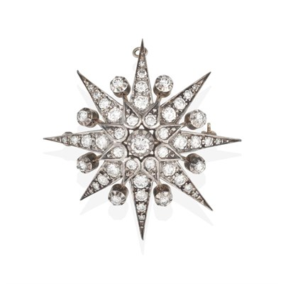 Lot 2027 - A Diamond Star Brooch, a round brilliant cut diamond within a border of smaller round brilliant cut