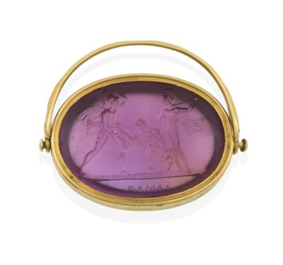 Lot 2029 - An Amethyst Intaglio Swivel Fob, the oval amethyst depicting a figure subject with Roman...