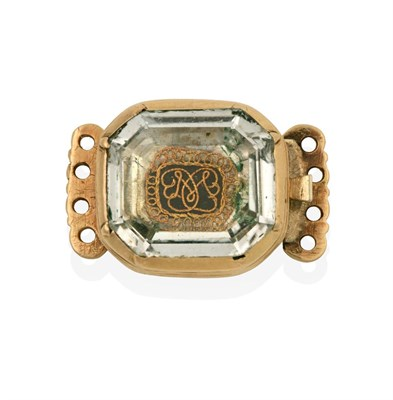 Lot 2030 - A Stuart Crystal Clasp, the emerald-cut rock crystal laid upon a hairwork and wirework plaque, with