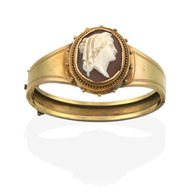 Lot 2032 - A Victorian Cameo Bangle, the oval cameo depicting a lady in profile, within a yellow ropetwist and