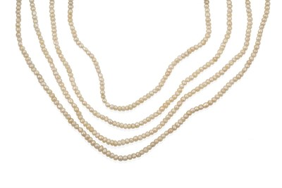 Lot 2037 - A Seed Pearl Necklace, the four rows of seed pearls knotted to a torpedo shaped clasp set...