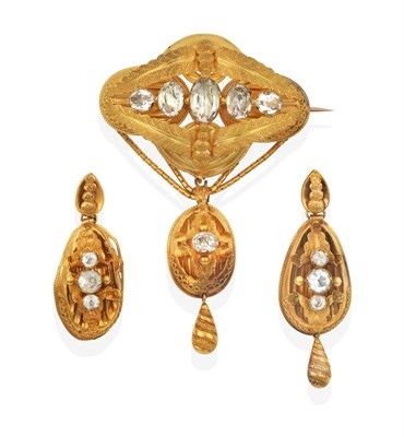 Lot 2038 - A Victorian Aquamarine Brooch, five graduated oval cut aquamarines in yellow collet settings within