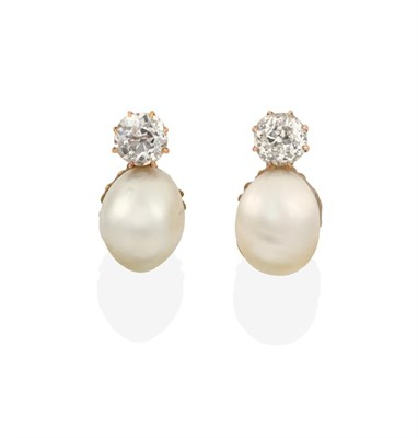 Lot 2039 - A Pair of Pearl and Diamond Earrings, an old cut diamond set above a pearl, in yellow claw...