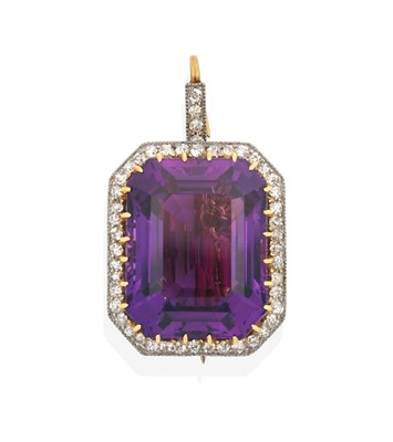 Lot 2040 - An Amethyst and Diamond Brooch/Pendant, the emerald-cut amethyst in a yellow claw setting,...