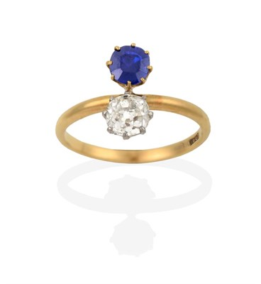 Lot 2041 - A Sapphire and Diamond Two Stone Ring, the old cut diamond in white claw settings and the...