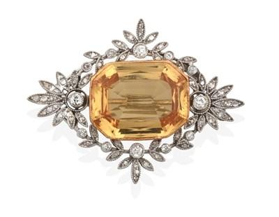 Lot 2042 - An Edwardian Diamond and Yellow Topaz Brooch, the rectangular cut yellow topaz in a yellow...