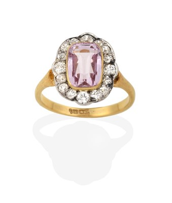 Lot 2044 - A Pink Tourmaline and Diamond Cluster Ring, the cushion cut pink tourmaline in a yellow rubbed over