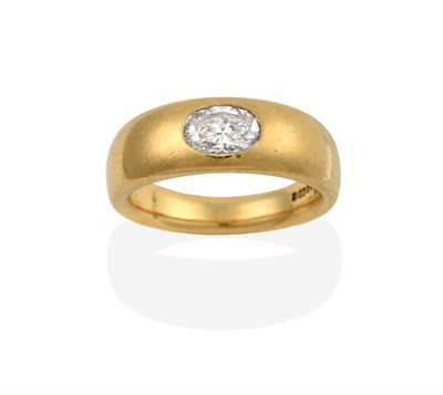 Lot 2046 - An 18 Carat Gold Diamond Solitaire Ring, an oval cut diamond inset into a yellow plain polished...