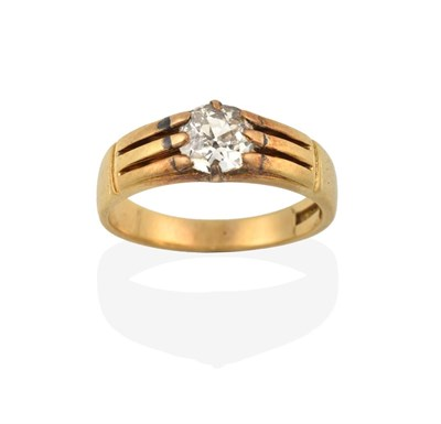 Lot 2048 - A Diamond Solitaire Ring, the old cut diamond in a yellow claw setting, to a grooved shoulder plain
