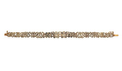 Lot 2052 - A 9 Carat Gold Alexandrite Bracelet, of abstract form, set throughout with rose cut alexandrites in