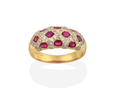 Lot 2055 - An 18 Carat Gold Synthetic Ruby and Diamond Ring, the domed top inset with oval cut synthetic...