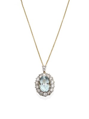 Lot 2056 - An Aquamarine and Diamond Cluster Pendant on Chain, the oval cut aquamarine within a border of...