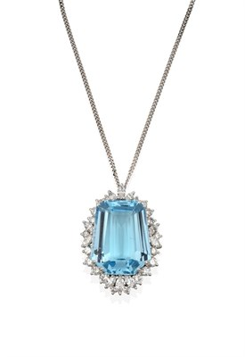 Lot 2057 - An Aquamarine and Diamond Cluster Pendant on Chain, the fancy cut aquamarine within a border of...
