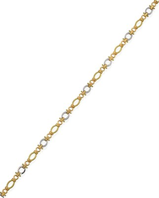 Lot 2058 - An 18 Carat Gold Diamond Fancy Link Necklace, by Boodle & Dunthorne, eight yellow textured oval...