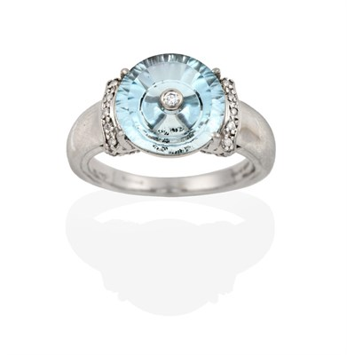 Lot 2059 - A 9 Carat White Gold Blue Topaz and Diamond Ring, the fancy cut blue topaz with an eight-cut...