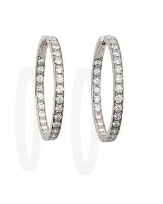 Lot 2066 - A Pair of 18 Carat White Gold Diamond Hoop Earrings, round brilliant cut diamonds set to the...