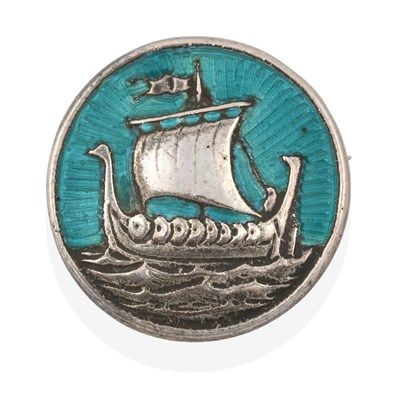 Lot 2069 - An Enamel Iona brooch, by Alexander Ritchie, the circular plaque depicting a Viking ship and...