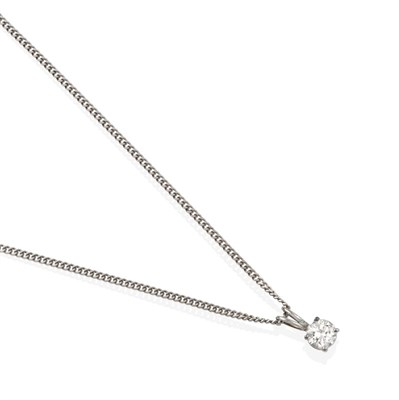 Lot 2070 - A Diamond Solitaire Pendant on Chain, the round brilliant cut diamond in a four claw setting,...