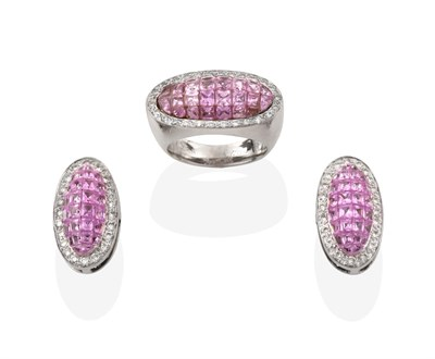 Lot 2071 - A Pink Sapphire and Diamond Ring, the central domed plaque formed of calibré cut pink...
