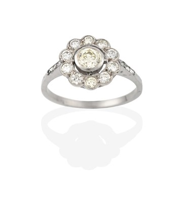 Lot 2073 - A Diamond Cluster Ring, the round brilliant cut diamond within a border of smaller round...