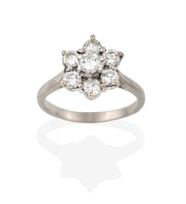 Lot 2074 - A Diamond Cluster Ring, the raised central round brilliant cut diamond within a border of round...