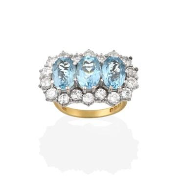 Lot 2077 - An 18 Carat Gold Aquamarine and Diamond Triple Cluster Ring, three oval cut aquamarines within...