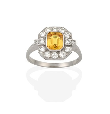 Lot 2085 - An Art Deco Style Yellow Sapphire and Diamond Ring, the central emerald-cut yellow sapphire...