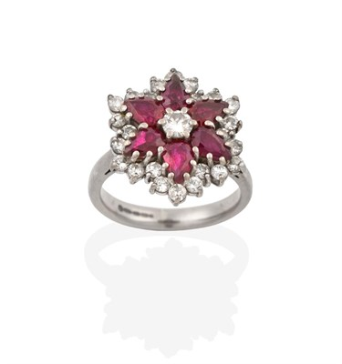 Lot 2086 - An 18 Carat White Gold Ruby and Diamond Cluster Ring, the central round brilliant cut diamond...