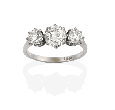 Lot 2090 - A Diamond Three Stone Ring, the graduated old cut diamonds in white claw settings, to a tapered...