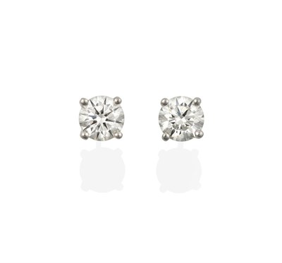 Lot 2091 - A Pair of 18 Carat White Gold Diamond Solitaire Earrings, the round brilliant cut diamonds in...