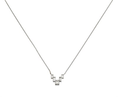 Lot 2092 - A Diamond Necklace, mounted by Cartier, five graduated step cut diamonds in white rubbed over...