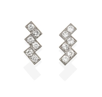 Lot 2093 - A Pair of Diamond Earrings, mounted by Cartier, three pairs of round brilliant cut diamonds...