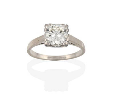 Lot 2094 - A Diamond Solitaire Ring, the round brilliant cut diamond in a white four claw setting, to a...