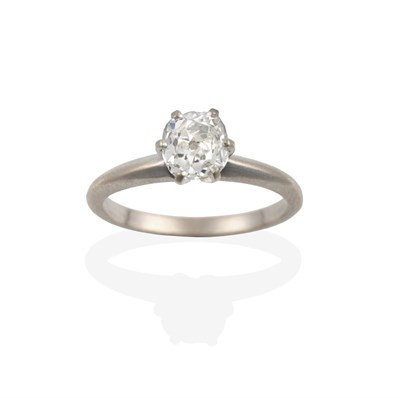 Lot 2095 - An 18 Carat White Gold Diamond Solitaire Ring, the old cut diamond in a claw setting, to a...