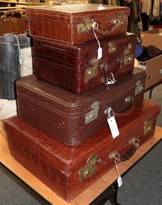 Lot 1022 - Brown crocodile mounted dressing case, with hinged cover enclosing three compartments with...