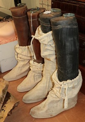 Lot 1024 - A pair of brown leather knee high riding boots with wooden trees and brass ring pulls, and a...