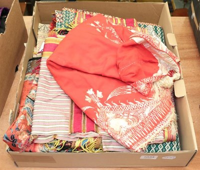 Lot 1034 - Eastern woven decorative panels, an Indian red cape with cream embroidery, striped silk scarf, red