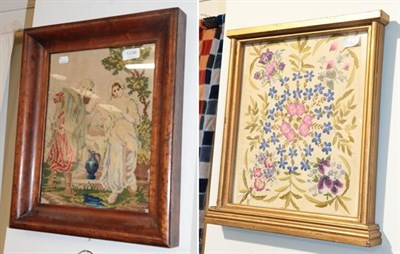Lot 1036 - A decorative silk embroidery of pansies and cornflower's, worked on a cotton canvas, in a gilt...