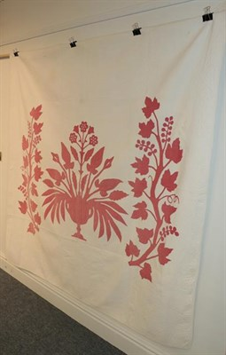 Lot 1041 - 19th century white quilt with large red cotton appliquéd image of a central pedestal vase of...