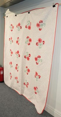 Lot 1042 - 20th century decorative American bed cover, worked in red threads, with applique flowers, with...