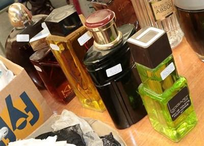 Lot 1050 - Large glass scent bottle dummy factices, comprising Colours de Benetton, Bogart pour Homme, K...