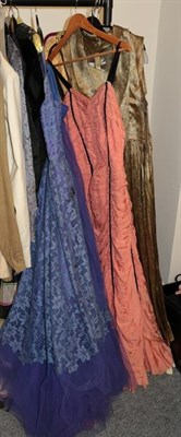 Lot 1058 - Circa 1940s and later evening dresses, including lace mounted examples, velvet dresses, mainly full