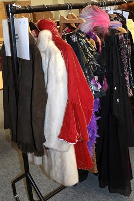 Lot 1059 - Assorted costume and theatrical costume, including a grey mink double breasted coat, a brown...