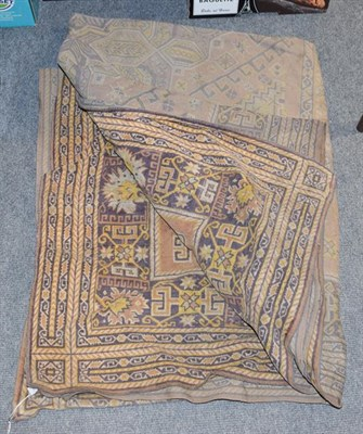 Lot 1088 - An early 20th century machine made wall hanging with geometric border