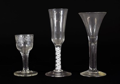 Lot 17 - An Ale Flute, circa 1760, the ogee funnel bowl on an opaque twist stem, 18cm high; A Similar...